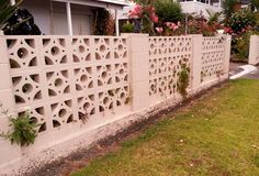 A fancy breeze block fence, nicely done.