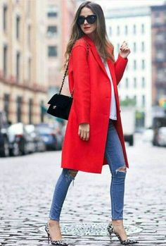 Red coat over blue jeans and white tee.
