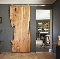 #beautiful slice of #wood doubling up not only as a #feature And #installation but as a #wooden sliding #door too!