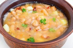 Bacon and Pinto Bean Stew - tRufelka Elena/shutterstock Large Family Meals, Family Fresh Meals, Healthy Family Meals, Large Families, New Recipes, Soup Recipes, Cooking Recipes, Slow Cooker Recipes Family, Lemon Herb Chicken