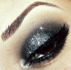 Stacey created this drop dead gorgeous look with Sugarpill Bulletproof and some glitter on top!