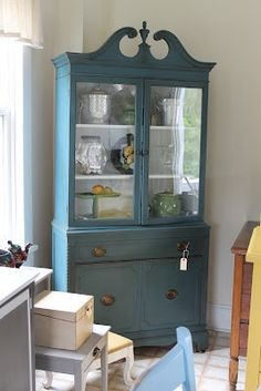 painted china cabinet. Bold color with white inside?