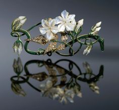 Lalique - 1899-1901 'jasmine' corsage pin | 18K gold/ diamond leaves/ mother-of-pearl flowers/ green enamel. Muse Lalique, Rue du Hochberg, Alsace, France