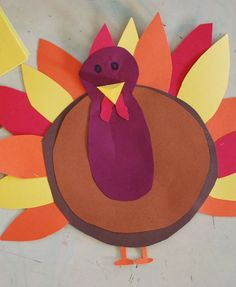 Thanksgiving crafts and art projects: Turkey Window Decorations. Materials: Construction paper, glue, and markers.