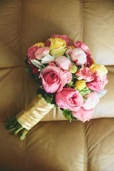 always love pink and yellow bouquets, photo by Onelove Photography http://ruffledblog.com/1920s-inspired-ace-hotel-wedding #pink #flowers #bouquets