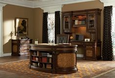 "Rawling Executive Desk (08947-320-076) – Made from New Zealand pine and ash burl veneer and a hand-tooled leather top.  Features include seven drawers.  Bottom left and right drawers accommodate letter or legal size files; six shelves on the front for display.  Dimensions – 76 ½"" W x 38""D x 31 ½"" H.  Shown with Rawling Credenza, Rawling Hutch and Rawling File Cabinet. www.ambellahome.com"