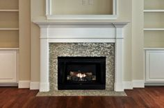 Fireplace with glass tile + traditional white-painted wood surround. Maybe use a touch of this tile in kitchen backsplash?