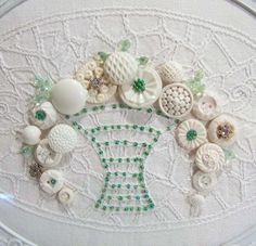 Altered Vintage Linen Button Art done in white and green in the Cottage Shabby Chic Style. $55.00, via Etsy.