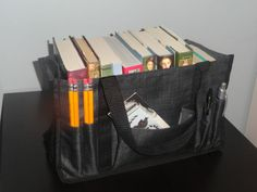 This is a great textbook holder for all those students: highschool, college, law school, nursing school...This is Thirty-One's Keep-It-Caddy!  :)