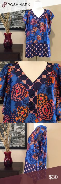Anthro Fei Blue & Orange Short Sleeve Blouse Anthro Fei Blue & Orange Short Sleeve Blouse. Really pretty and feminine top. Ruffle, flounce style sleeves. Mixed colors and pattern - blues, oranges, pink. V-Neck with button closure. Buttons are different (see second pic); I purchase this way but wanted to note it. 100% polyester. Excellent condition. Lightweight and comfy top that can be dressed up or down. Size small. Anthropologie Tops