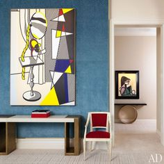 The room's 1977 Roy Lichtenstein canvas hangs above an Hervé Van der Straeten console from Ralph Pucci International; a 1958 Picasso painting is displayed in the hall.