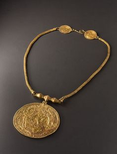 Byzantine Braided Gold Necklace with a Medallion representing Fortune and Bellerophon A Bracelet with Pseudo-Medallions - 6th century A.D. | © Phoenix Ancient Art 2011