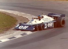 Ronnie Peterson sliding the six-wheeled Tyrrell P34.