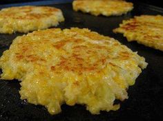 Cheesy Cauliflower Patties  1 head cauliflower 2 large eggs 1/2 c cheddar cheese, grated 1/2 c panko salt olive oil Cook in boiling water until tender about 10 minutes. Drain. Mash the cauliflower while still warm. Stir cheese, eggs, panko, Coat the bottom of a griddle or skillet with olive oil over medium-high heat. Form the cauliflower mixture into patties about 3 inches across. Cook until golden brown & set, about 3 minutes per side.