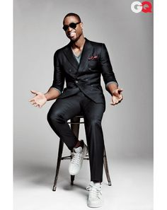 Suit, $1,995, and sneakers, $495, by Yves Saint Laurent. Sweater, $735 by Gucci. Sunglasses by Salvatore Ferragamo. Pocket square by Tom Ford. Socks by Falke.