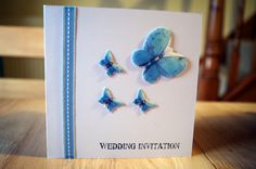 Handmade wedding invitations. Butterfly made with seeded paper. They were perfect for our wildlife themed diy wedding. Also good for blue or yellow colour schemes as these are the options for the butterfly shapes!