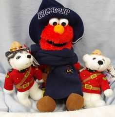 Getting ready for their Arctic Adventure on Feb. 18th here at the Centre   From Left to Right: RCMP Sgt. Rrrruff; Elmo and RCMP Sgt. Snowflake. Elmo's wardrobe provided by the RCMP Heritage Centre's 'Central Trading Post' : Scarf, blue fleece with logo and toque, blue/grey knit.   ph. (306) 522-7333 ext 3000 or through our e-store.   http://www.rcmpheritagecentre.com/home/estore