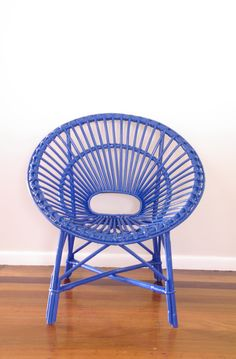 Made to Order -  Upcycled Vintage Cane Saucer Chair Neon Blue. $151.00, via Etsy.