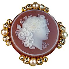 Victorian Era finely carved carnelian cameo of Dionysus set in 18K gold bezel embellished with half pearls and rose cut diamond