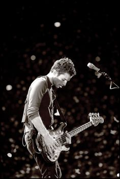 Guy Berryman from Coldplay! I love him!!! And I looooovve this picture!