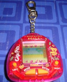 Another of mine: Giga-Pets-Computer-Koala-Electronic-Keychain-Tiger-Awesome-Condition // ...and we had a few others. Think Fred still has our big orange dino one, and I may have had at least one other. A Dalmatian, perhaps?