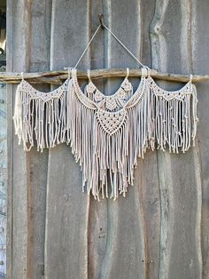 Large Macrame Wall Hanging This beautiful and unique wall hanging will add a lovely handmade element to any room in your home. With a couple hundred meters of cotton rope woven into her bones, it is a statement piece that will flood your space with energy and inspiration and is sure to