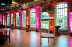 The Cotton Room - Durham, NC - great light through the windows and colored light on the inside, courtesy of Simpsound DJ and Sighting Services  -  http://ncweddingministerblog.blogspot.com/2012/02/light-creates-dramatic-impact-for-your.html