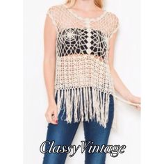 Beige crocheted geometric fringed top. NWT Beige round neckline- sleeveless - geometric design with scalloped hem and fringe. 55% cotton and 45% acrylic. This is a size medium. Boutique Tops
