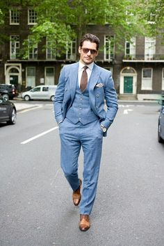 Shop this look for $573:  http://lookastic.com/men/looks/dress-pants-and-waistcoat-and-dress-shirt-and-derby-shoes-and-pocket-square-and-tie-and-double-breasted-blazer/1760  — Light Blue Dress Pants  — Light Blue Waistcoat  — White Dress Shirt  — Walnut Leather Derby Shoes  — Beige Silk Pocket Square  — Brown Tie  — Light Blue Double Breasted Blazer