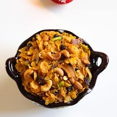 Corn chivda - an Indian snack made by mixing cornflakes with variety of nuts and spices.