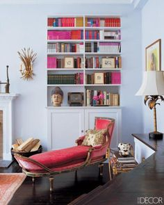 Killer chaise! color coordinated bookshelf is pretty cool.