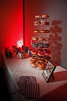 Donut Tower. I was thinking of donuts as a dessert table option because I think they would make for a whimsical tea party kind of look. They would be cheap too!