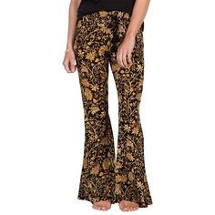 Women's Volcom Golden Lantern Print Flare Pants (66 CAD) ❤ liked on Polyvore featuring pants, bronze, floral pattern pants, volcom pants, floral trousers, floral pants and patterned pants