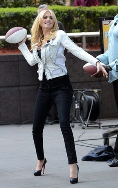 Kate Upton throws footballs in her Louboutin High Heels. Yes, she can! #CL #Streetstyle