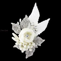 This glamorous vintage style bridal hair accessory has beautiful ivory fabric flower and leaf detail  enhanced with sparkling crystal