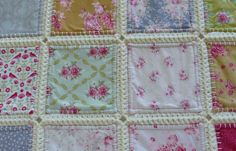 A quilt but slightly different.  This quilt measures 48 by 80 inches and fits easily on a single bed.  This quilt contains 84 Tilda fabric squares