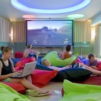 Colourful bean bags, cushions. Teen games room.