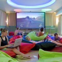 Colourful bean bags, cushions. Teen games room.