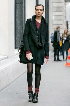 It's hard to rock boots with socks, but she does it. Brava!