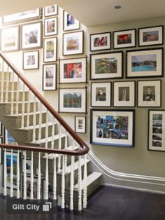 Picture gallery up the stairs. This is what I was thinking of doing, with large, framed vintage travel posters interspersed in there, too.