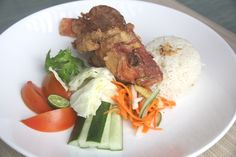 Lalapan Ikan Kakap Terbang  Deep fried butterfly whole baby snapper with Balinese crudities and sambals.