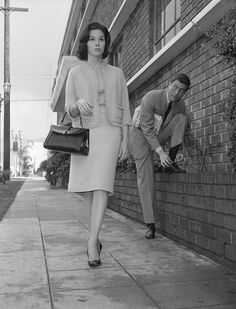 Actor Dick Van Dyke looks on as his co-star Mary Tyler Moore walks by in a publicity still for The Dick Van Dyke Show, Feb. 22, 1962. - A Look Back At The Life Of Mary Tyler Moore In Pictures - BuzzFeed News