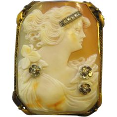 Large hand carved cameo set in 14K yellow gold with eight diamonds