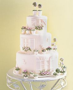 A garden villa is transformed into a fondant masterpiece with white chocolate flowerpots and shutters so real, you can almost hear them creak. Gateaux Inc., gateaux-inc.com