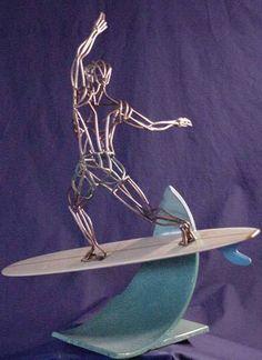 Greg Hill's Surfing Surfer Sculpture Statue Weblink: http://www.sportsteel.com/gallery/sports/surfer.html