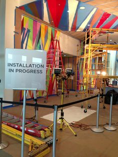Installation of 'Heaven's Gate' by Odili Donald Odita is coming right along in the SCADMOA lobby. Love all the colors!