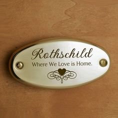 """The Where We Love door plate is an ideal housewarming gift for newlyweds or a welcoming family. Each brass door plate features the phrase, """"Where We Love Is Home"""" and has ample room for a short personalized message or the family name to be laser engraved on the plate."""