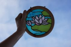Water Lilly stained glass on turned oak frame.