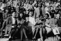 Drama in the Stands at a 1940's Howard University Homecoming Game [photo from http://LIFE.com]  There is some exquisite old-school side-eye going on in the front row... and the woman between the target and the one slinging it is doing her best to disappear into thin air. [Can't locate the original; maybe it did not actually run in the magazine? It wasn't printed in the Nov 1946 photo essay on Howard.]