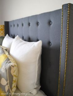 DIY Headboards: The classic look of a wingback headboard brings so much style to a room. Even if you're on a tight budget, you can include this elegantly styled headboard in your design. Upholstered Wingback Headboard